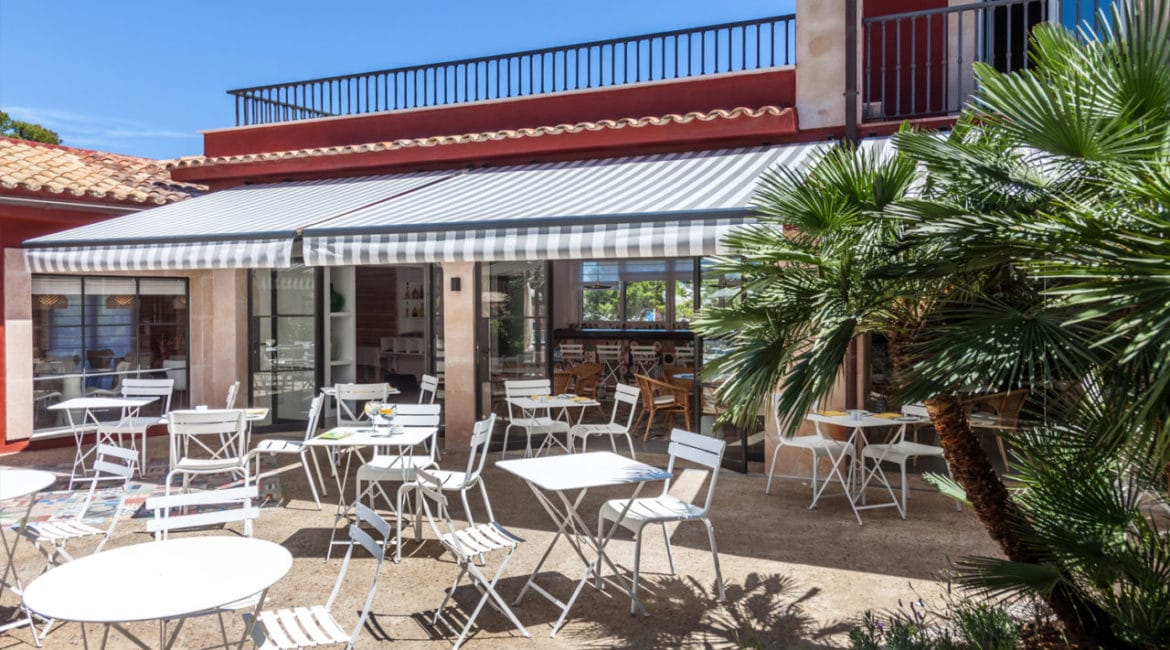 Dine by the pool at Cala sant Vicenc Hotel