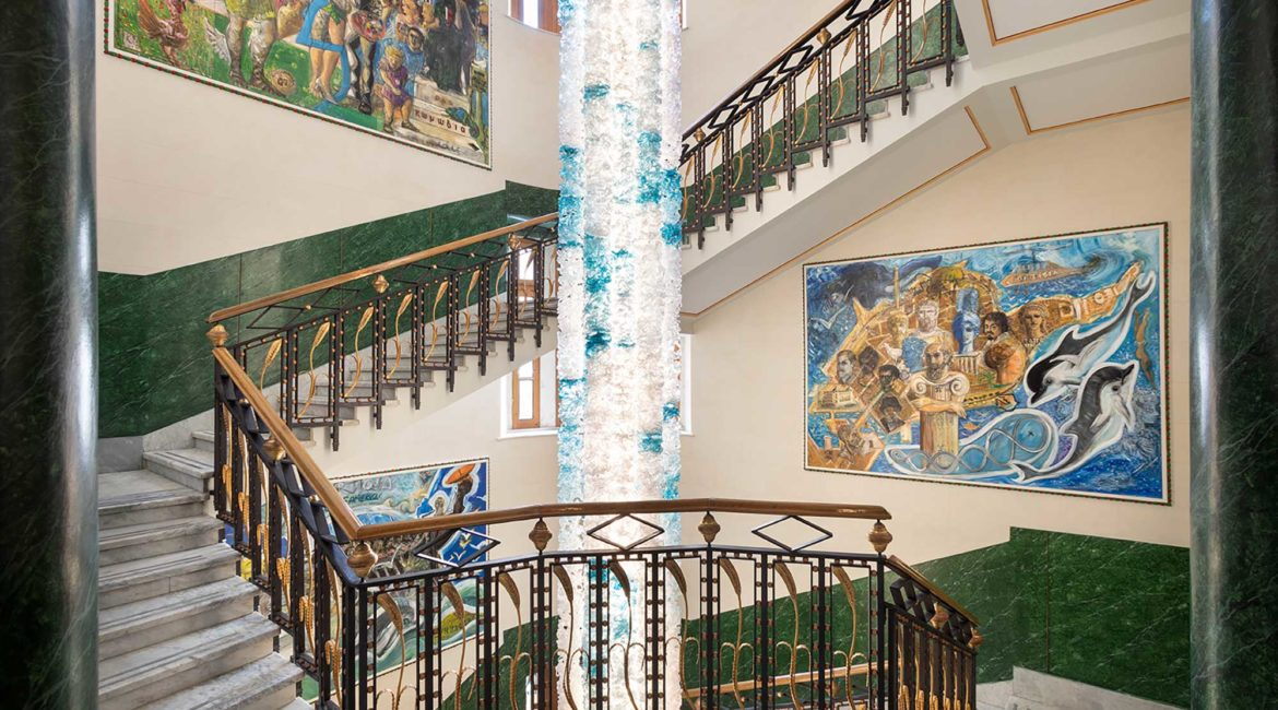 The beautifil marble staircase and Murano chandelier at Ortea Palace